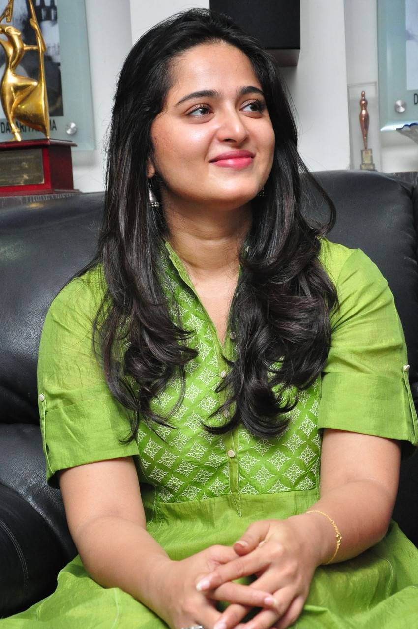 Actress Anushka Long Hair Stills In Green Dress