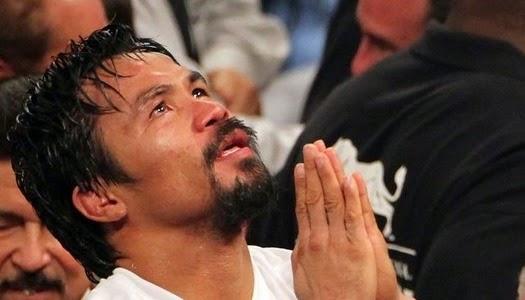 Manny Pacquiao orando