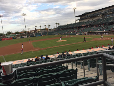 The stadium of the Fresno Grizzlies at the start of the first innings. Many seats are empty as players play ball on the park.