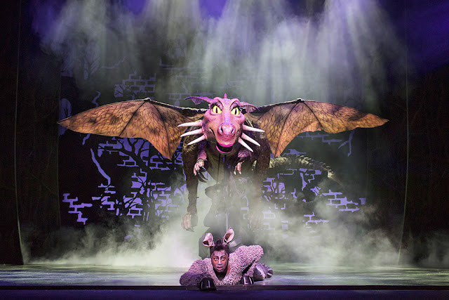 Shrek the Musical's Dragon, hovering above a slightly scared looking Donkey