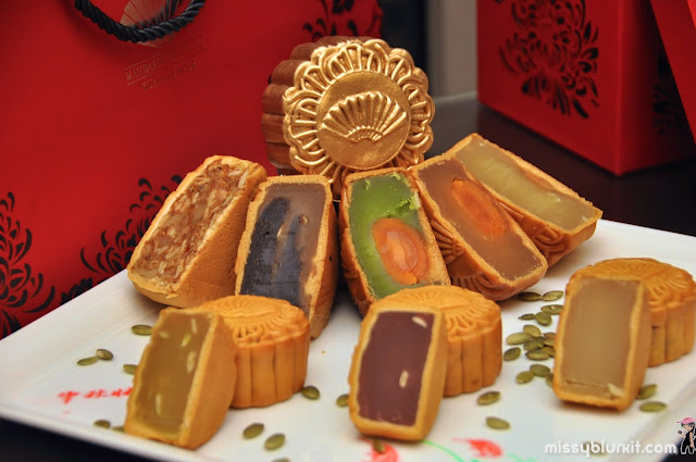 baked and gold coated mooncakes