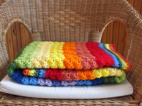 https://www.etsy.com/listing/188568303/colorful-handmade-crochet-rainbow-baby?ref=favs_view_4