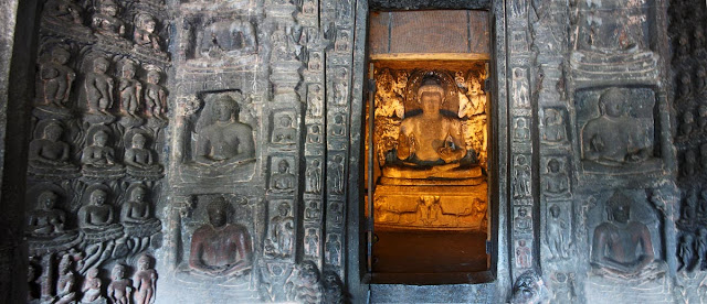 buddha in the inner sanctum surrounded by small Buddhas