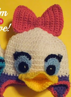 http://www.craftsy.com/pattern/crocheting/accessory/free-donald--daisy-inspiredhat-pattern/131577