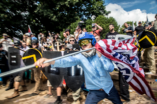 William Fears battling protesters during the Charlottesville rally in 2017. Credit Mark Peterson/Redux
