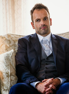 Jonny Lee Miller as Sherlock Holmes in CBS Elementary Season 2 Episode 6 An Unnatural Arrangement