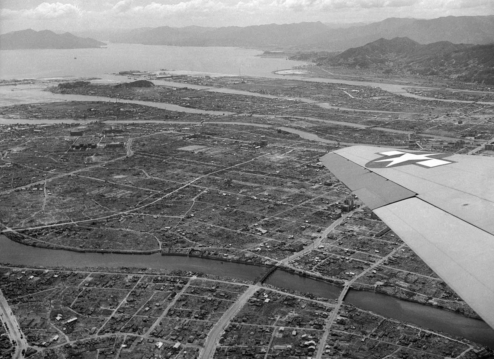 Aerial view of Hiroshima, Japan, one year after the atomic bomb blast shows some small amount of reconstruction amid much ruin on July 20, 1946. The slow pace of rebuilding is attributed to a shortage of building equipment and materials.