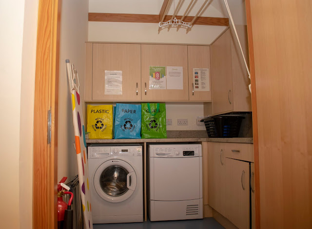Utility room comprising of washing machine, dyer, recycling bags and cabinets