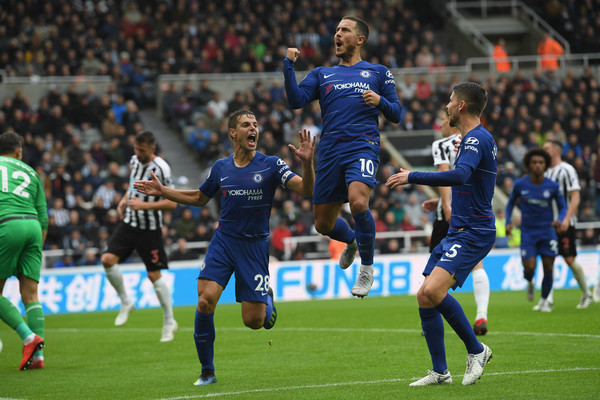 Chelsea player Eden Hazard (c) ceebrates after scoring the first chelsea goal during the Premier League match between Newcastle United and Chelsea FC at St. James Park on August 26, 2018 in Newcastle upon Tyne, United Kingdom. (Aug. 25, 2018 - Source: Stu Forster/Getty Images Europe)