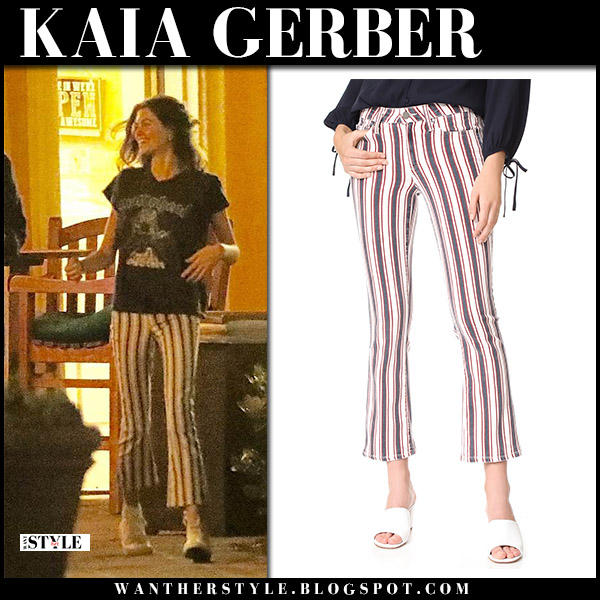 Kaia Gerber in black t-shirt and striped pants model style may 31