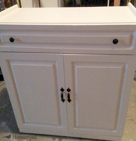 Wooden cabinet painted white