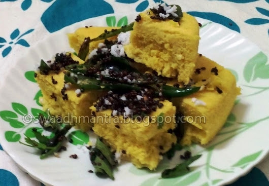 Khaman-Dhokla - A traditional Gujarati Dish - Split Chikpea flour mixed with curd, fermented, steamed and garnished