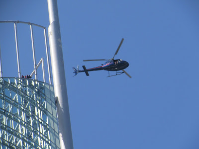 Helicopter over Q1 Tower