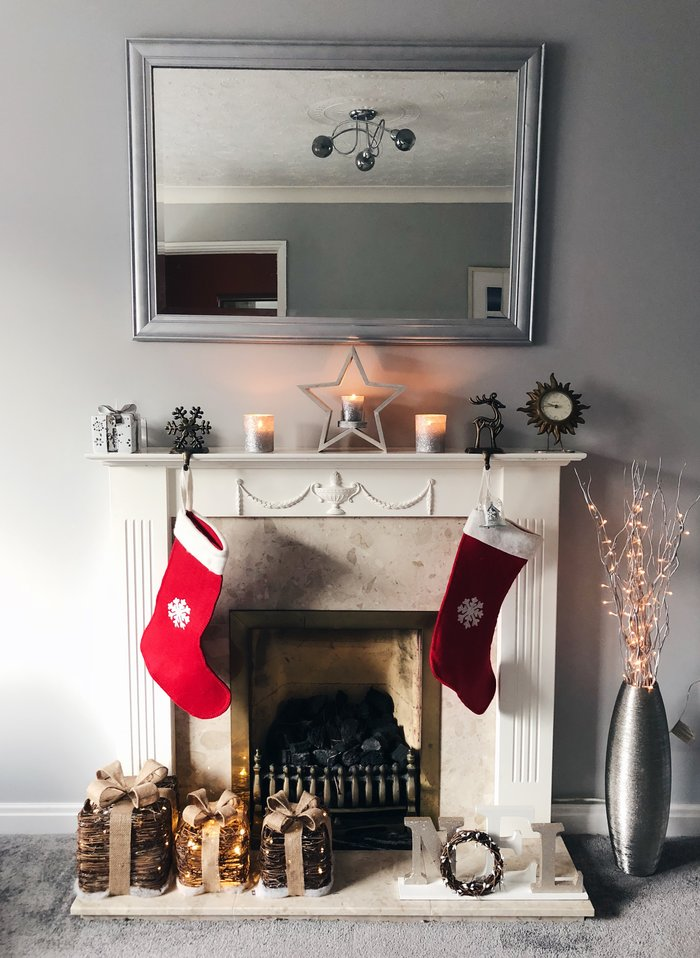 grey room with mantlepiece and christmas decorations