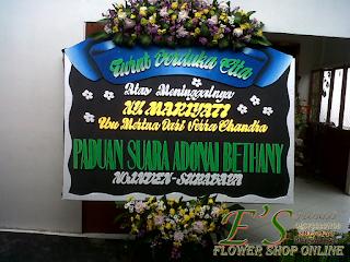 papan bunga ucapan duka