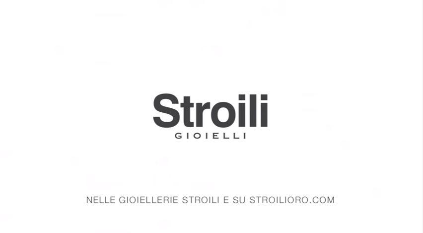 Modello e modella Stroili Oro pubblicità con coppia sul letto e sotto la pioggia con foto spot