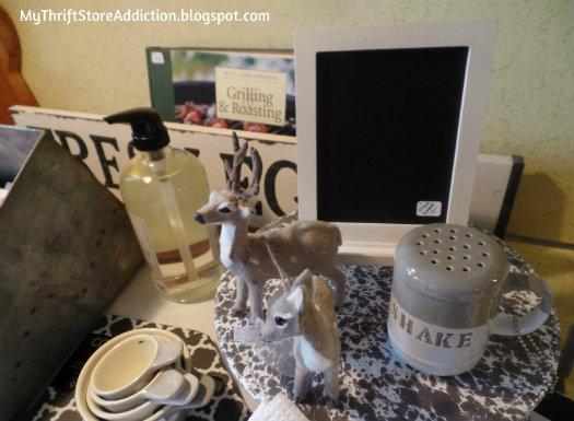 Smitten! mythriftstoreaddiction.blogspot.com Woodland deer display on gray spatterware cakestand in the kitchen