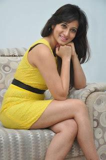 Actress Harshika Poonacha Stills in Yellow Short Dress at Appudala Ippudila Movie Promotions  0056.jpg