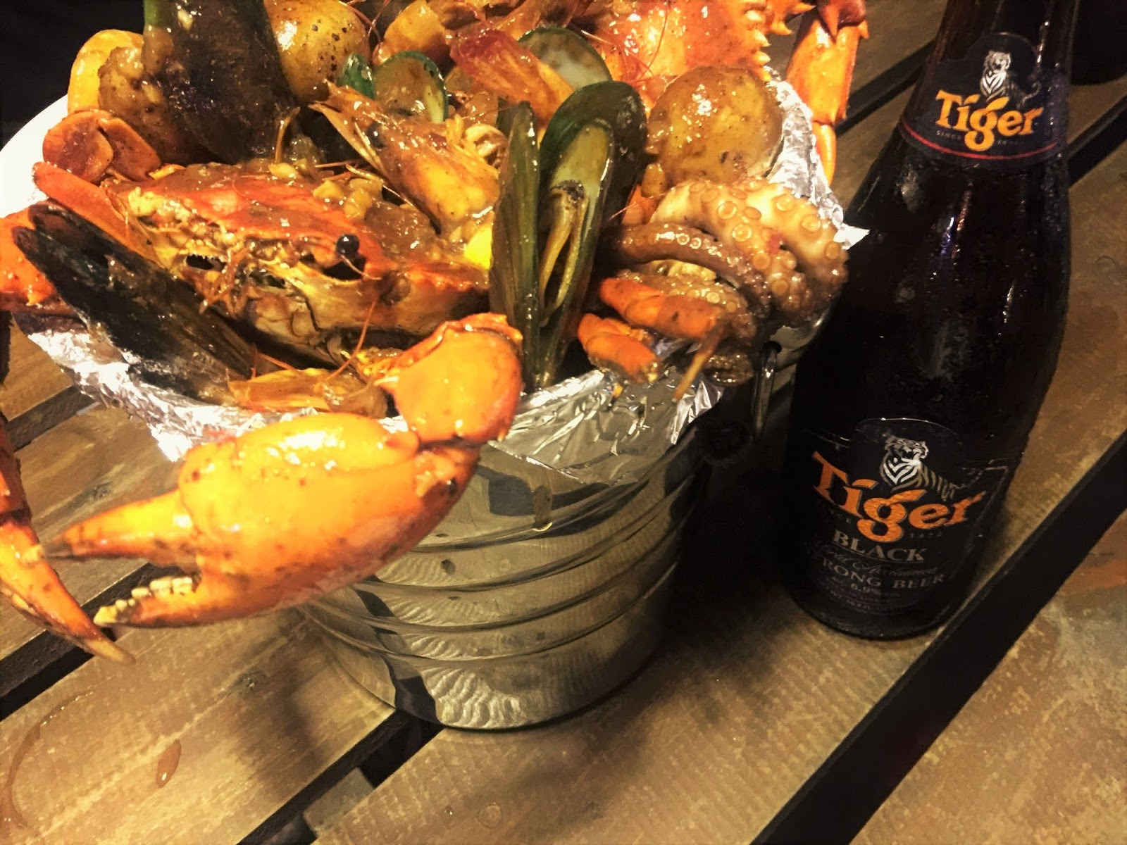 Mixed Seafood Cajun Bucket and Tiger beer in Hailey's Seafood and Barbecue