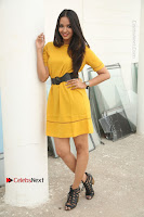 Actress Poojitha Stills in Yellow Short Dress at Darshakudu Movie Teaser Launch .COM 0120.JPG