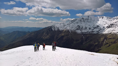 Descending from Capanna 2000 in snow and Cima Menna in the background.