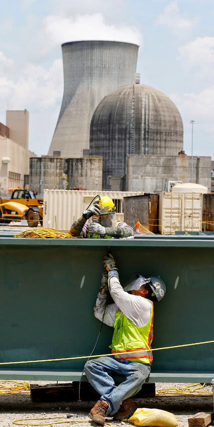 Workers building a nuclear reactor in Waynesboro, Ga., one of just five under construction in the United States, where nuclear energy is waning. (Credit: John Bazemore/Associated Press) Click to Enlarge.