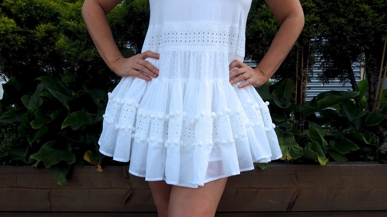 flouncy white dress with pom poms