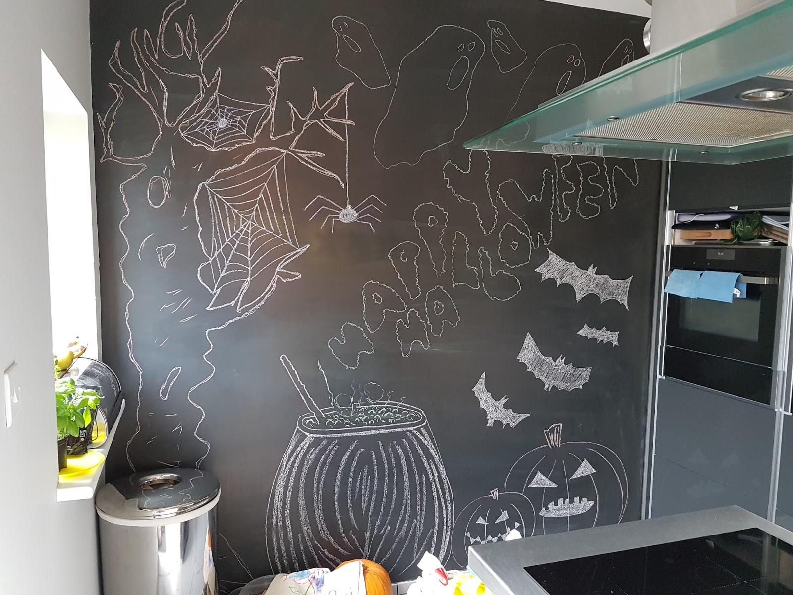 halloween blackboard art wall with chalk pictures of pumpkins and spiders