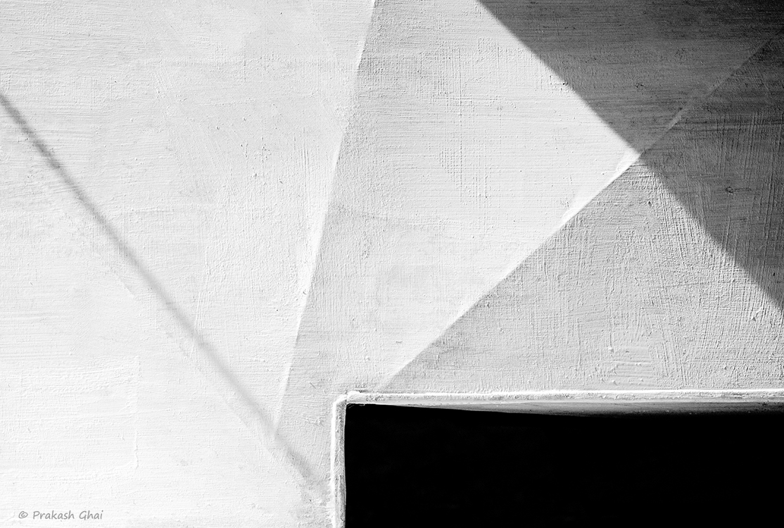 A Black and white Minimalist Photo of Lines Vs the Triangle Vs the Rectangle