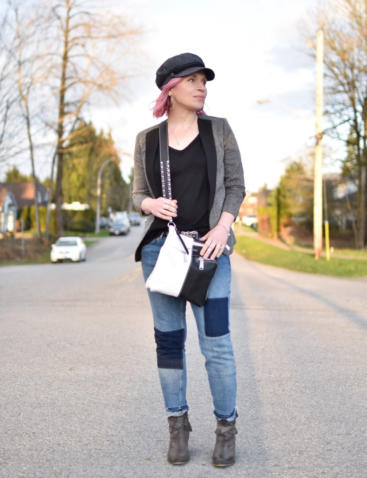 Monika Faulkner outfit inspiration - styling patchwork jeans with a blazer, western-inspired booties, and a baker boy cap
