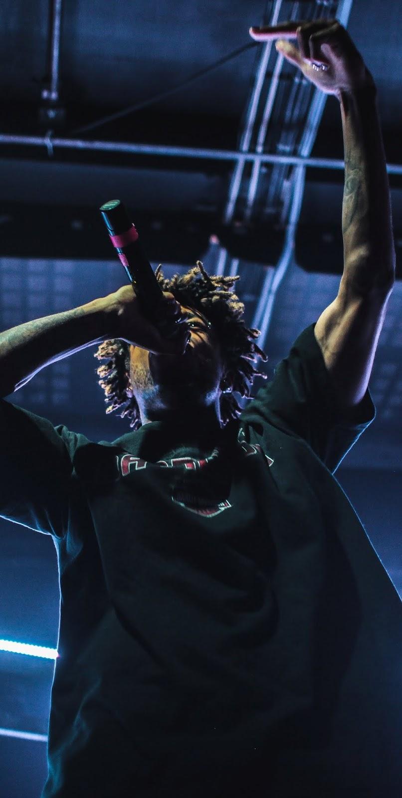 A rapper singing.