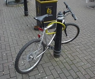 stupid job of locking a bicycle to a post