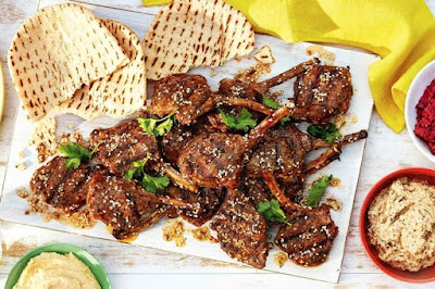 For the perfect spring platter serve up these succulent Middle Eastern infused lamb cutlet Za'atar lamb cutlet platter with dips recipe