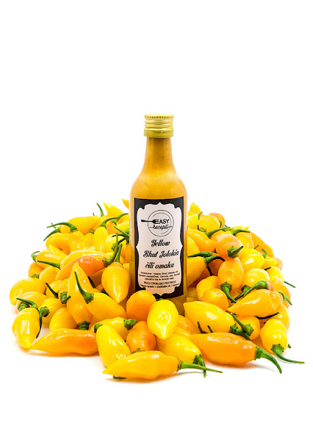 Yellow chili sauce single bottle with chili