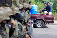 TWO DEAD AS HONDURAN ARMY ENFORCES CURFEW WHILE VOTE COUNT STALLS