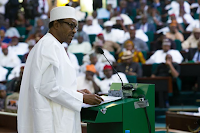 Buhari rejects devaluation of Naira says foreign exchange business had become a scam to drain the Nigeria economy.