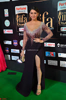 Hansika Motwani in Glittering Deep Neck Transparent Leg Split Purple Gown at IIFA Utsavam Awards 009.JPG