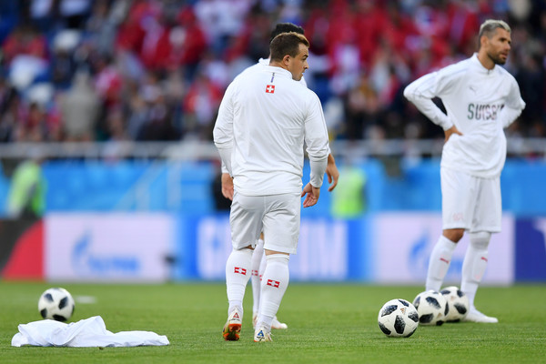 The Kosovo flag is seen on Xherdan Shaqiri of Switzerland's boots during warm up prior to the 2018 FIFA World Cup Russia group E match between Serbia and Switzerland