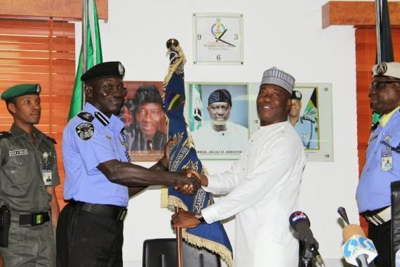 pics md abubakar hands over to new ig of police suleiman