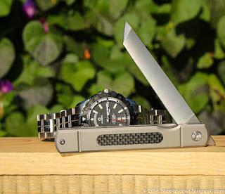 Kesiwo KS66 titanium frame-lock front flipper with CF inlay