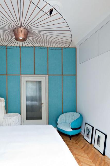 Pietro Russo design with blue walls chevron floor and constance guisset vertigo pendant