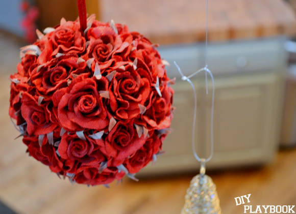 You can use large ornaments like this rose hanging ornament or small ones.