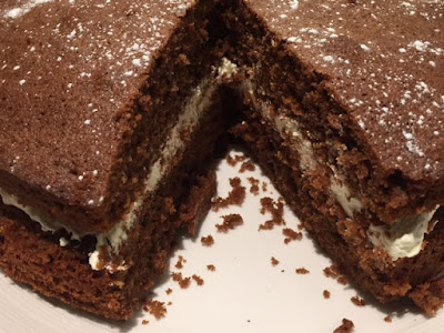 Chocolate Sandwich Cake with a slice cut out.