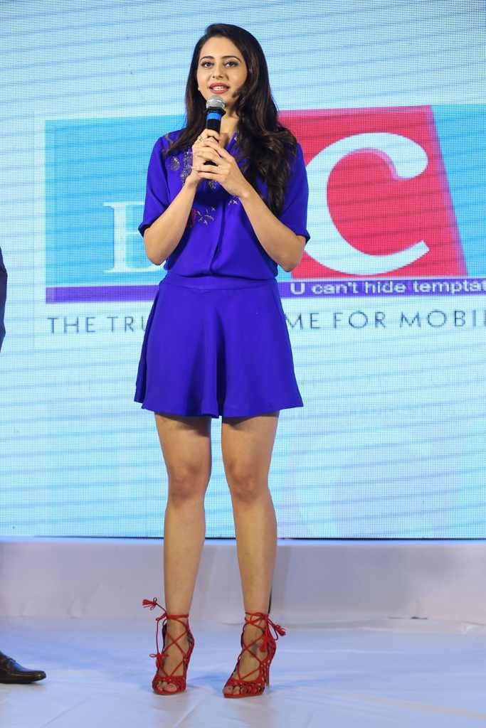 Telugu Actress Rakul Preet Singh Legs Show Stills At Big C Shop In Mini Blue Skirt