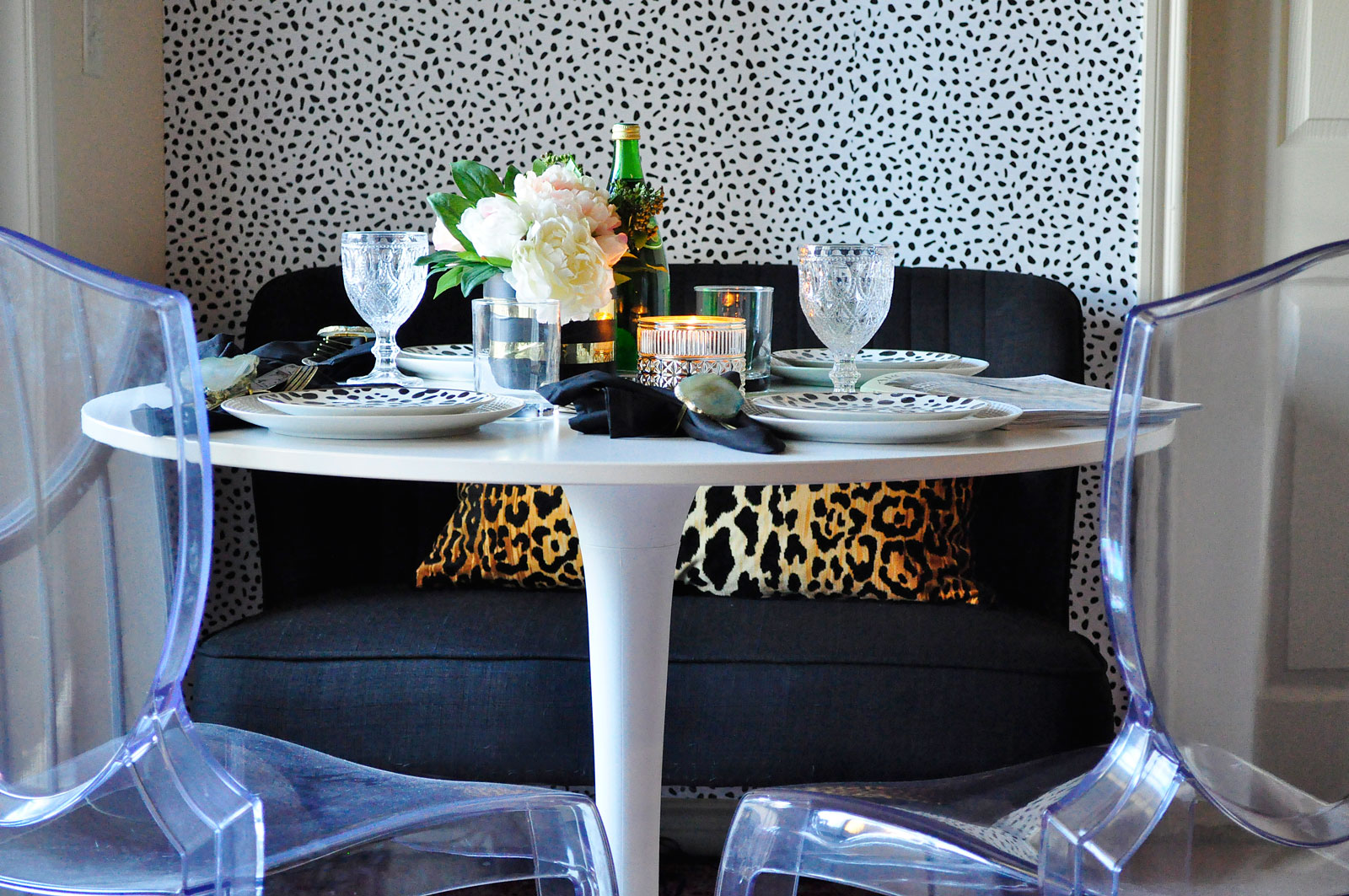 Black and white temporary wallpaper in a small dining room space with glam and eclectic decor.
