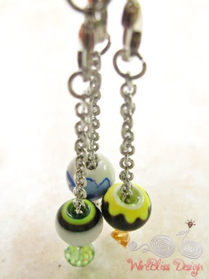 Wire wrapped charms with yellow colored big beads and porcelain bead