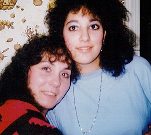 A snapshot of a middle-aged woman and teenage girl of Italian descent, smiling and embracing