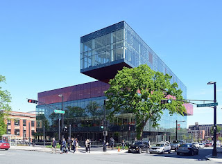 Large glass building on a busy intersection