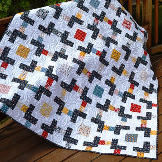 Charm Square Quilt designed by Melissa Corry of Happy Quilting Melissa