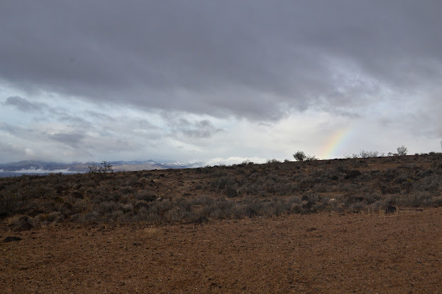 start on a gentle slope overlooked by a rainbow